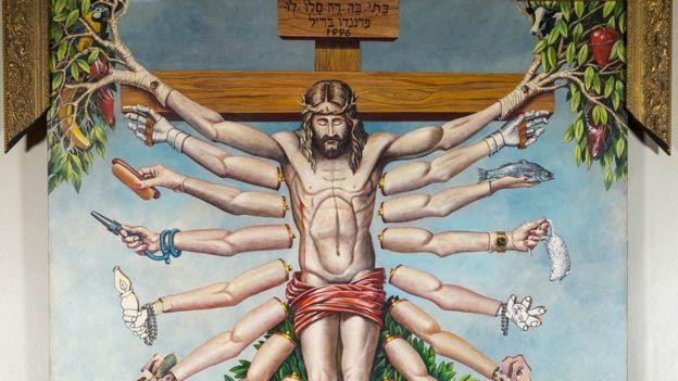 Jesus crucificado com os múltiplos braços da deusa do hinduísmo